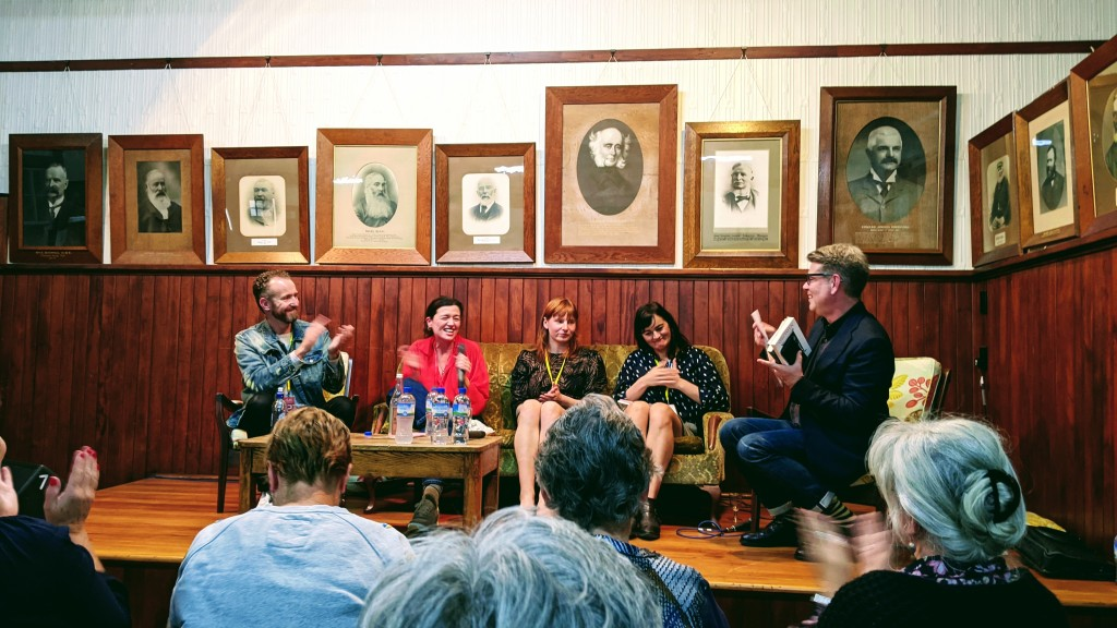 Author panel discussion at Anzac Hall, Featherston, with John Campbell, Ashleigh Young, Noelle McCarthy, Madison Hamill, and Carl Shuker.