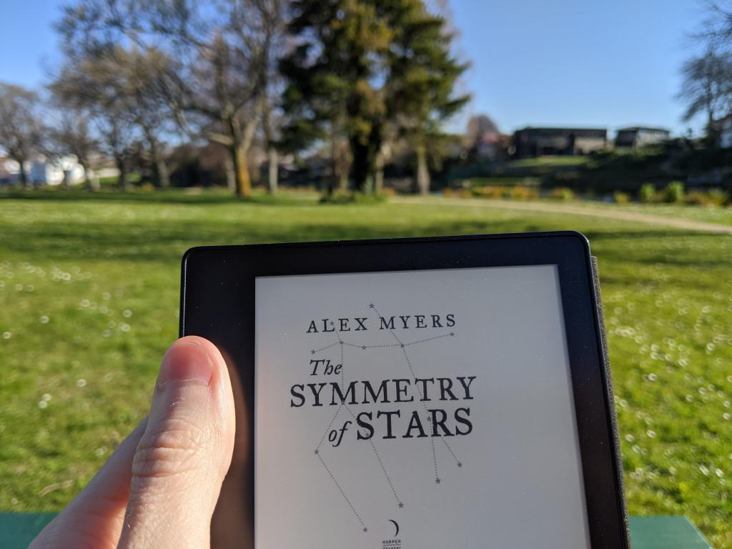 The Symmetry of Stars by Alex Myers - digital ARC on Kindle in the park